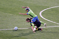COLUMBUS, OH - DECEMBER 12: Raul Ruidiaz #9 of the Seattle Sounders FC trips over Aidan Morris #21 of the Columbus Crew during a game between Seattle Sounders FC and Columbus Crew at MAPFRE Stadium on December 12, 2020 in Columbus, Ohio.