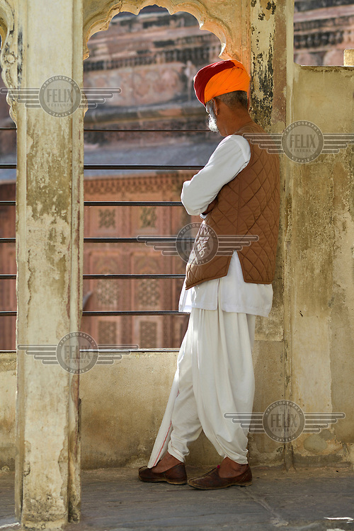 A uniformed palace guard/attendant at Mehrangarh Fort/Palace.