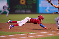 Clearwater Threshers Yhoswar Garcia (9) dives back to first base on a pickoff attempt during a game against the Tampa Tarpons on June 10, 2021 at BayCare Ballpark in Clearwater, Florida.  (Mike Janes/Four Seam Images)