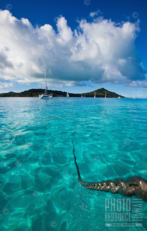 Raising the anchor in Bora Bora's crystal clear lagoon
