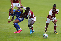 5th September 2020; PTS Academy Stadium, Northampton, East Midlands, England; English Football League Cup, Carabao Cup, Northampton Town versus Cardiff City; Curtis Nelson of Cardiff City competes for the ball with Christopher Missilou of Northampton Town