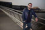 © Joel Goodman - 07973 332324 . NO SYNDICATION PERMITTED . 19/03/2015 . Salford Quays , UK . SHAUN RYDER at Salford Quays . Black Grape photocall at The Green , Salford Quays , Greater Manchester . Black Grape are reforming for a Madchester charity gig along with other local bands , to raise awareness for Bez's Reality Party and anti-fracking . Photo credit : Joel Goodman