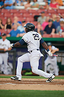 Kane County Cougars first baseman Yoel Yanqui (29) follows through on a swing during a game against the South Bend Cubs on July 23, 2018 at Northwestern Medicine Field in Geneva, Illinois.  Kane County defeated South Bend 8-5.  (Mike Janes/Four Seam Images)