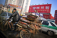 CHINA. Jiangxi Province.  Jiujiang. A man carries cardboard and paper to be taken for recycling. Jiujiang is a city of 4.6 million people, located on the southern shore of the Yangtze River. The Yangtze River is reported to be at its lowest level in 150 years as a result of a country-wide drought. It is China's longest river and the third longest in the world. Originating in Tibet, the river flows for 3,964 miles (6,380km) through central China into the East China Sea at Shanghai.  2008