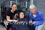 Orlaith Mangan who cut her hair for the Rapunzel Association in Sean Taaffes hair salon Killarney on Friday l-r: Breda Murphy hair stylist, Orlaith and Eileen Mangan