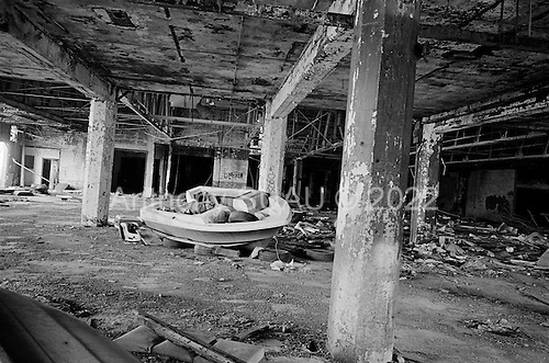 Detroit, Michigan<br /> USA<br /> March 24, 2009<br /> <br /> The Packard plant - once called Motor City Industrial Park is five minutes from downtown Detroit. These modern-day ruins were created by wave after wave of lay-offs and corporate collapses of the Detroit auto industry.<br /> <br /> Known as the world's automotive center Detroit was once the home of 1.85 million people in the 1950's. It now houses 917,000 and for this reason it is said that there are now 80,000 abandoned buildings within the city.