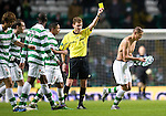 Celtic v St Johnstone....26.12.10  .Cha Du Ri is booked for taking his shirt off.Picture by Graeme Hart..Copyright Perthshire Picture Agency.Tel: 01738 623350  Mobile: 07990 594431
