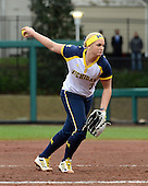Michigan Wolverines pitcher Megan Betsa (3) delvers a pitch during the season opener against the Florida Gators on February 8, 2014 at the USF Softball Stadium in Tampa, Florida.  Florida defeated Michigan 9-4 in extra innings.  (Copyright Mike Janes Photography)