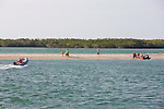People Hang Out On Sand Bar