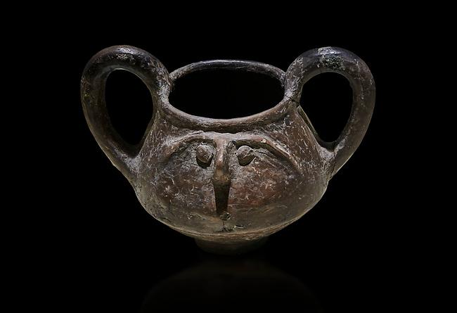 Hittite terra cotta double handled jug with a relief human face- 17th - 16th century BC - Hattusa ( Bogazkoy ) - Museum of Anatolian Civilisations, Ankara, Turkey . Against black background
