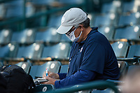 Minnesota Twins scout John Manuel takes notes during the minor league baseball game between the Hickory Crawdads and the Greensboro Grasshoppers at First National Bank Field on May 6, 2021 in Greensboro, North Carolina. (Brian Westerholt/Four Seam Images)