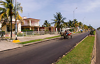 Street scenes of transportation and real life along the Malacon in Cienfuegos Cuba with horse drawn carriages