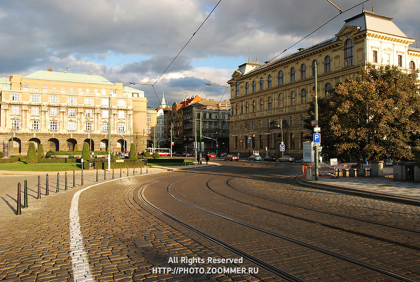 Prague street of bricks with tram lines going to bridge near Jan Pallach Square