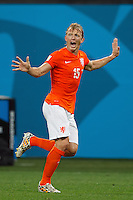 Dirk Kuyt of the Netherlands screams and runs
