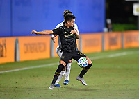 LAKE BUENA VISTA, FL - JULY 18: Eduard Atuesta #20 of LAFC shields the ball from an opponent during a game between Los Angeles Galaxy and Los Angeles FC at ESPN Wide World of Sports on July 18, 2020 in Lake Buena Vista, Florida.