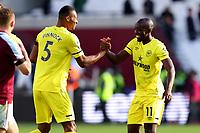 3rd October 2021;   City of London Stadium, London, England; EPL Premier League football, West Ham versus Brentford; Yoane Wissa of Brentford celebrates the 1-2 win with Ethan Pinnock