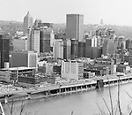 Pittsburgh PA:  View of the city's skyline.  The view includes the construction of the Pittsburgh Press Building and downtown Pittsburgh.  The view also includes the many businesses along Fort Pitt Boulevard.