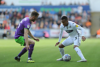 Marley Watkins of Bristol City vies for possession with Martin Olsson of Swansea City during the Sky Bet Championship match between Swansea City and Bristol City at the Liberty Stadium, Swansea, Wales, UK. Saturday 25 August 2018