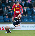 Raith's Simon Mensing goes in late on Pars' Andrew Geggan ...