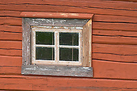 Traditional style Swedish wooden painted house. Window Smaland region. Sweden, Europe.