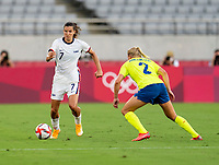 TOKYO, JAPAN - JULY 21: Tobin Heath #7 of the USWNT dribbles during a game between Sweden and USWNT at Tokyo Stadium on July 21, 2021 in Tokyo, Japan.