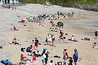 Pictured: People enjoy the sunshine in Langland Bay near Swansea, Wales, UK. Saturday 12 June 2021<br /> Re: Hot and sunny weather enjoyed in most parts of the UK.