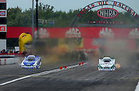 Sept. 5, 2011; Claremont, IN, USA: NHRA funny car driver Mike Neff (right) races alongside teammate Robert Hight during the US Nationals at Lucas Oil Raceway. Mandatory Credit: Mark J. Rebilas-