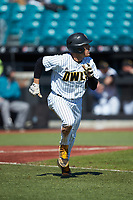 Alex Carballo (8) of the Kennesaw State Owls hustles down the first base line against the Western Carolina Catamounts at Springs Brooks Stadium on February 22, 2020 in Conway, South Carolina. The Owls defeated the Catamounts 12-0.  (Brian Westerholt/Four Seam Images)