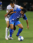 08 July 09: Charlie Davie (US) and Mariano Acevedo (HON) fight for the ballduring their match at the CONCACAF Gold Cup at RFK Stadium in Washington, DC.