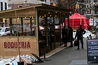 NEW YORK, NEW YORK - FEBRUARY 4:  workers wait for customers in a makeshift cabin at a local restaurant on February 12, 2021 in New York City. New York City is getting back their indoor dining with a restriction of 25 percent capacity. most of the restaurants have set up outdoor dining structures like pods, bubbles and lot of makeshift cabins . (Photo by Eduardo MunozAlvarez/VIEWpress)