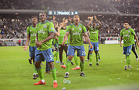 LOS ANGELES, CA - OCTOBER 29: Kelvin Leerdam #18, Nouhou Tolo #5, Roman Torres #29 and Luis Silva #23 of Seattle Sounders FC celebrate their MLS Western Conference victory by defeating Los Angeles FC 3-1 during a game between Seattle Sounders FC and Los Angeles FC at Banc of California Stadium on October 29, 2019 in Los Angeles, California.