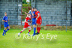 Tralee Dynamos Lorcan Seymour and Donal Kelliher of  Killarney Athletic tussle in the air, in the Denny Premier A soccer league game