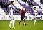 Real Valladolid's Alberto Guitian (l) and Alex Lopez (r) and Levante UD's Paco Montanes during La Liga Second Division match. March 11,2017. (ALTERPHOTOS/Acero)