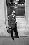 Bank security guard money courier with cash box delivering money to high street bank Devon 1979.