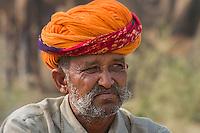 Camel  Trader  Portrait. A camel trader waits for customers. Pushkar Camel Fair, Rajasthan, India.