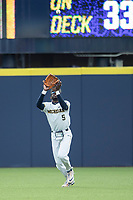 Michigan Wolverines outfielder Christian Bulloock (5) makes a catch against the Western Michigan Broncos on March 18, 2019 in the NCAA baseball game at Ray Fisher Stadium in Ann Arbor, Michigan. Michigan defeated Western Michigan 12-5. (Andrew Woolley/Four Seam Images)