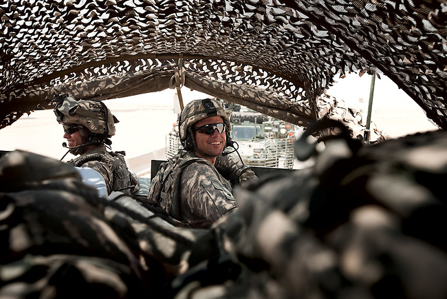SOUTHERN IRAQ 18 AUGUST 2010:  Staff Seargent Mike Poole (left) and Specialist Matt Taylor (right) of B/223 Company, Tomahawk Battalion of the 4/2 Strykers Brigades  smiling in their convoy en-route to the Kuwait border where they will be packing up and heading back to the USA.  Iraq is preparing after US President Barack Obama has confirmed the end of all combat operations in the country by 31 August..Some 50,000 of 65,000 US troops currently in Iraq are set to remain until the end of 2011 to advise Iraqi forces and protect US interests.The remaining 50,000 troops will stay in the country in order to train Iraqi security forces, conduct counterterrorism operations and provide civilians with ongoing security, said Mr Obama..An agreement negotiated with the Iraqis in 2008 states that these troops must be gone from the country by the end of next year. pic Graham Crouch/The Guardian