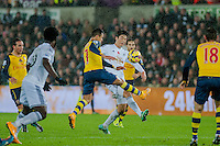 Sunday 9th November 2014<br /> Pictured: Ki Sung-Yueng of Swansea City battles with Alexis Sanchez of Arsenal <br /> Re: Barclays Premier League Swansea City v Arsenal at the Liberty Stadium, Swansea, Wales,UK