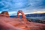 Red rock sweeping up to Utah's Delicate Arch