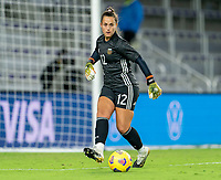 ORLANDO, FL - FEBRUARY 21: Laurina Oliveros #12 of Argentina passes the ball during a game between Canada and Argentina at Exploria Stadium on February 21, 2021 in Orlando, Florida.