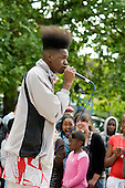 A Christian rapper performs at Westbourne Community Festival, Westbourne Green.