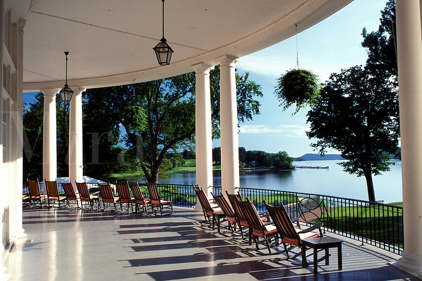 resort, rocking chairs, Cooperstown, New York, Rocking chairs on the porch of The Otesaga Resort Hotel overlooking Otsego Lake in Cooperstown, NY.