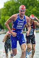 07 AUG 2011 - LONDON, GBR - Will Clarke (GBR) runs from the water at the end of the swim during the men's round of triathlon's ITU World Championship Series (PHOTO (C) NIGEL FARROW)
