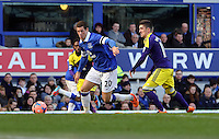 Pictured L-R: Ross Barkley of Everton is chased by Pablo Hernandez of Swansea. Sunday 16 February 2014<br /> Re: FA Cup, Everton v Swansea City FC at Goodison Park, Liverpool, UK.