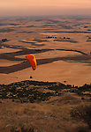 A paraglider sails around Steptoe Butte on a dusty summer day in the Palouse of Eastern Washington State.