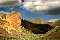 Rock formations and clouds in Leslie Gulch. Malhuer County, Oregon