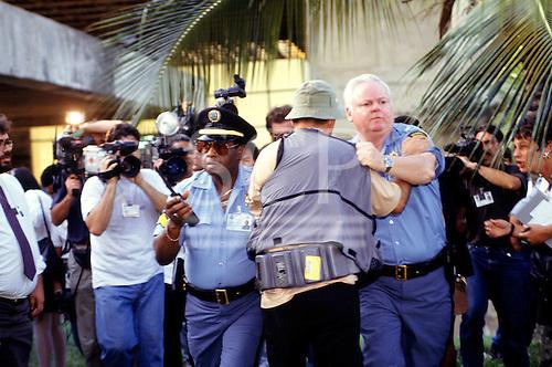 Rio de Janeiro, Brazil. UN security guards manhandling a television cameraman with other cameramen filming; UNCED Earth Summit, 1992.