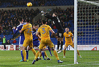 Chris Maxwell of Preston North End punches away the aerial threat during a corner in the Sky Bet Championship match between Cardiff City and Preston North End at Cardiff City Stadium, Wales, UK. Tuesday 31 January 2017