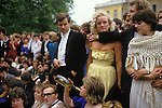 Students attend the annual may Ball up all night have their group Survivors Group Photograph taken the morning after the Commem Ball, Oxford, Magdalen College University 1980s England. Girl with bottle of wine is Emma Jenks.
