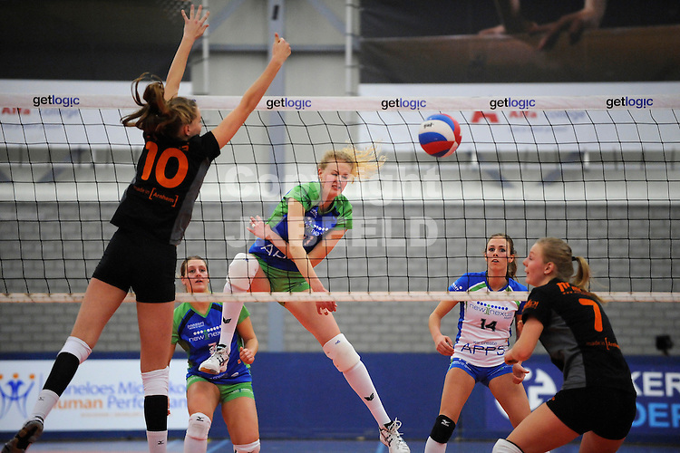 GRONINGEN - Volleybal, Lycurgus - Talententeam, eredivisie dames, seizoen 2013-2014, 14-12-2013,  Anneke Ykema slaat de bal langs het blok